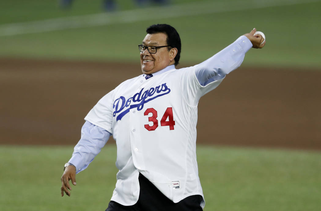 Retired Major League Baseball pitcher Fernando Valenzuela throws the inaugural ball during the regular-season major league baseball game between the San Diego Padres and the Los Angeles Dodgers in ...