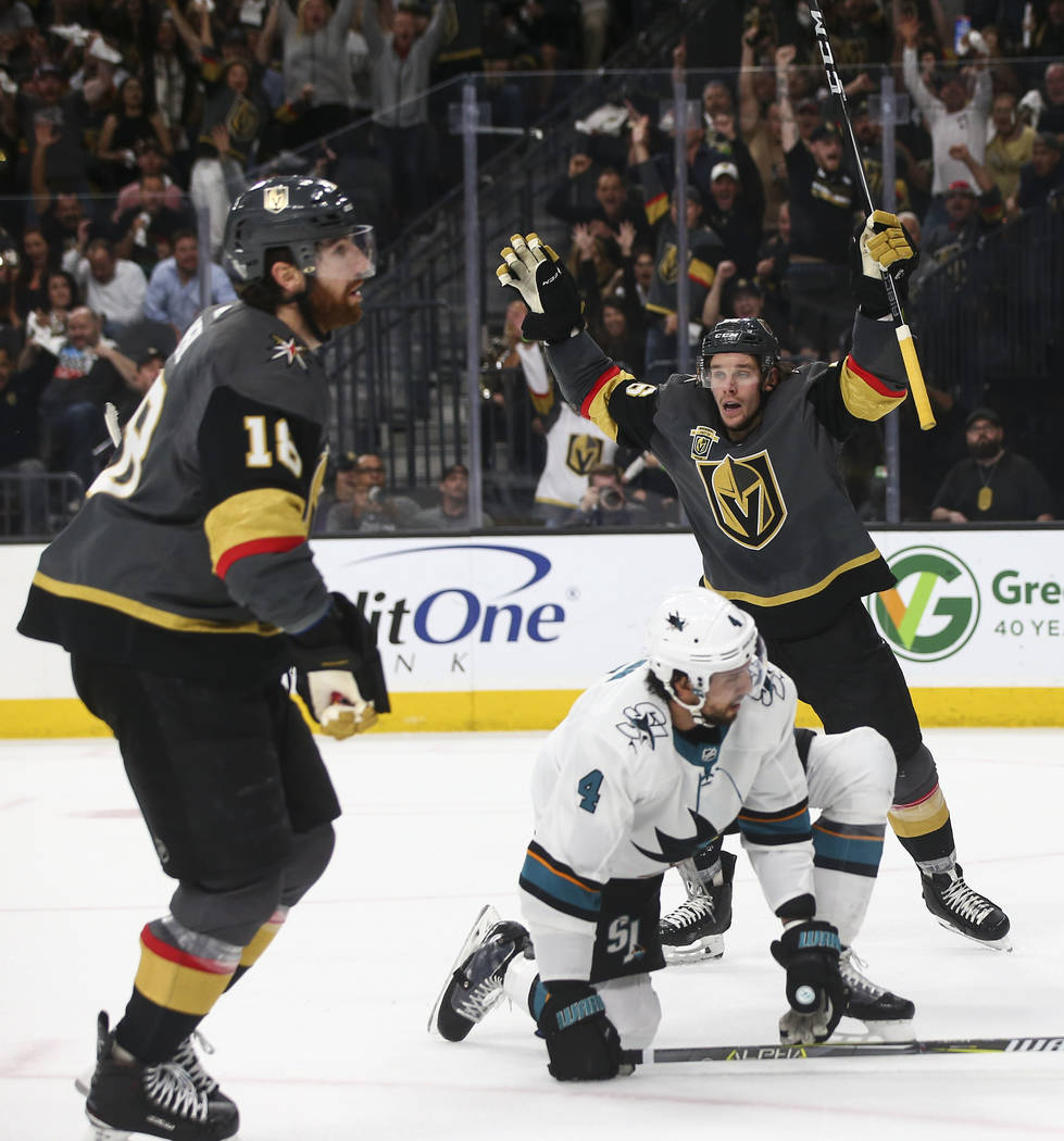 Golden Knights left wing Erik Haula (56) celebrates a goal by James Neal (18) against the San Jose Sharks during the first period of Game 5 of an NHL hockey second-round playoff series at T-Mobile ...