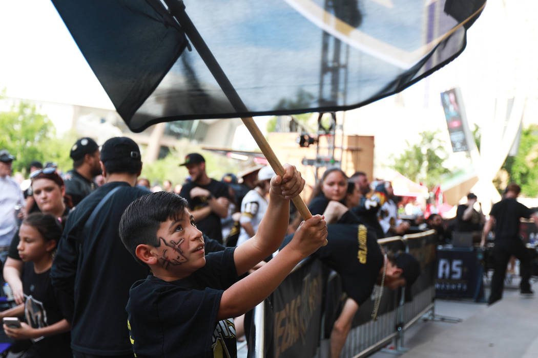 Daniel Arrieta, 9, waves a flag during a Vegas Golden Knights watch party for game six of the Stanley Cup playoffs outside on Toshiba Plaza in Las Vegas on Sunday, May 6, 2018. Andrea Cornejo Las ...