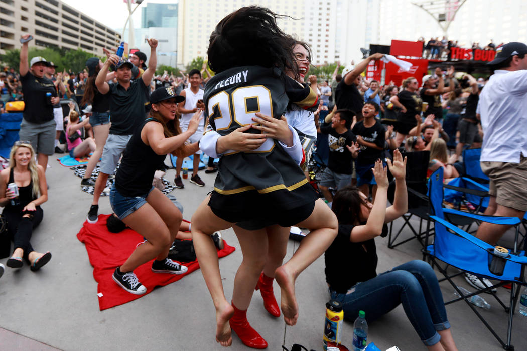 Gina Salerno, 18, back, embraces her sister Alexis Salerno, 16, both of Las Vegas, after the Vegas Golden Knights scored a goal during a watch party for game six of the Stanley Cup playoffs outsid ...