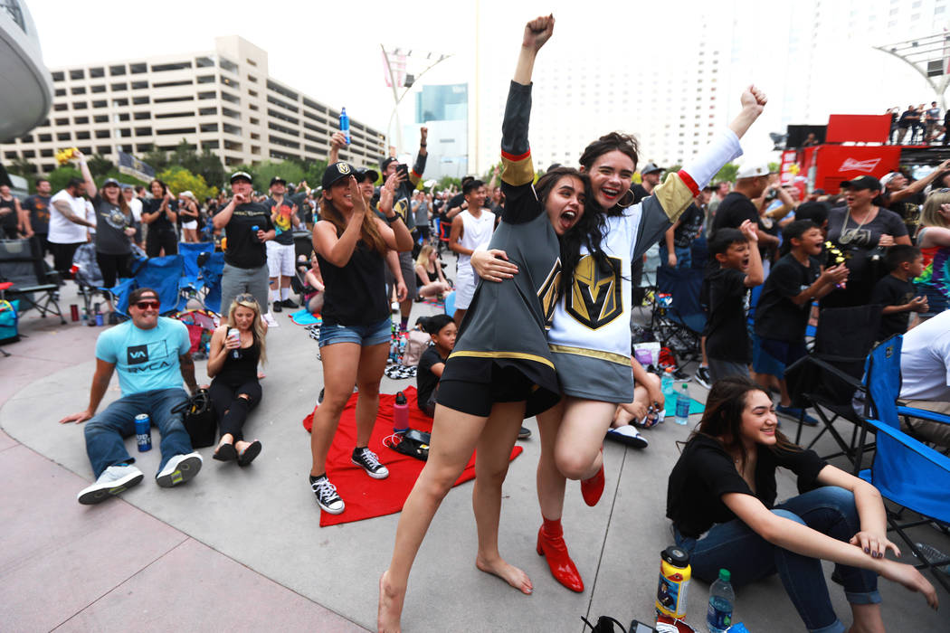 Alexis Salerno, 16, left, and her sister Gina, 18, both of Las Vegas, cheer after the Vegas Golden Knights scored a goal during a watch party for game six of the Stanley Cup playoffs outside on T ...