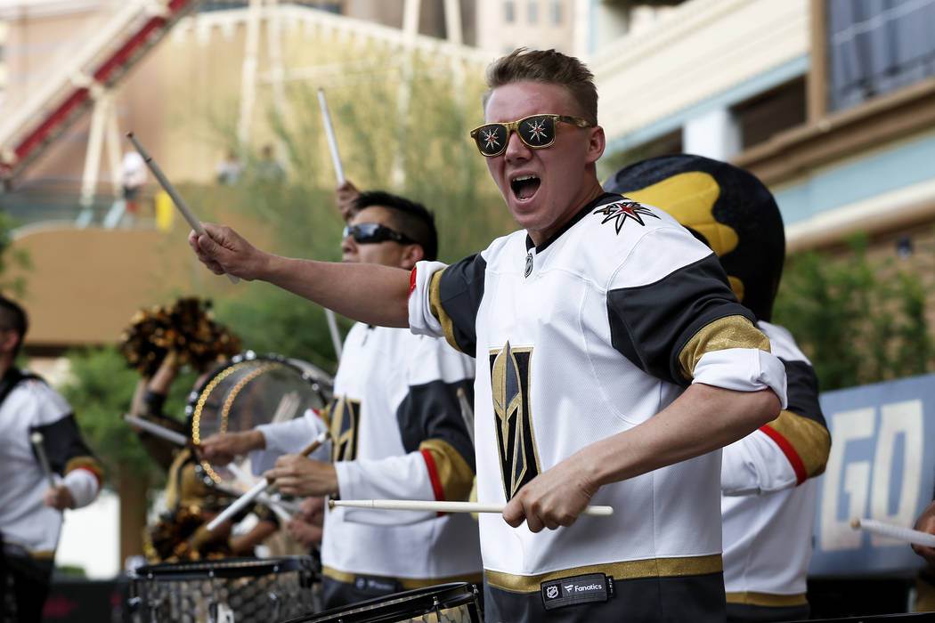 Members of the Knight Line perform for the crowd during a Vegas Golden Knights watch party for game six of the Stanley Cup playoffs outside on Toshiba Plaza in Las Vegas on Sunday, May 6, 2018. An ...