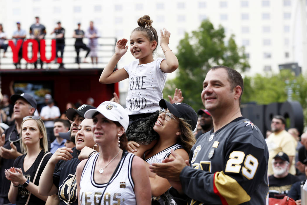 Heather Coronado hoists her 7-year-old daughter Aubrey, both of Las Vegas, during a Vegas Golden Knights watch party for game six of the Stanley Cup playoffs outside on Toshiba Plaza in Las Vegas ...