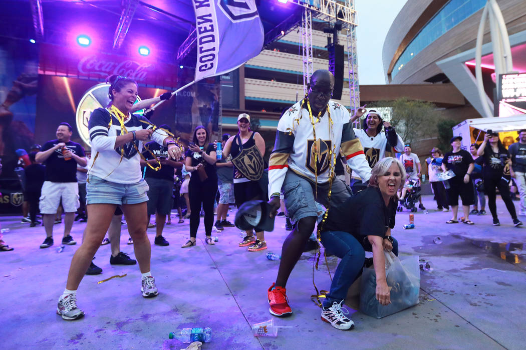 Roger Hallback, left, and Karlotta Sanchez, both of Las Vegas, celebrate after the Vegas Golden Knights defeated the San Jose Sharks during a watch party for game six of the Stanley Cup playoffs o ...