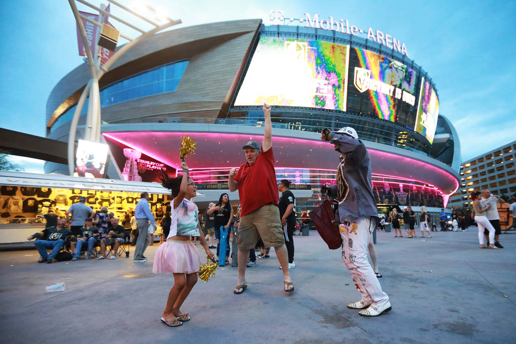 Fans celebrate after the Vegas Golden Knights defeated the San Jose Sharks during a watch party for game six of the Stanley Cup playoffs outside on Toshiba Plaza in Las Vegas on Sunday, May 6, 201 ...