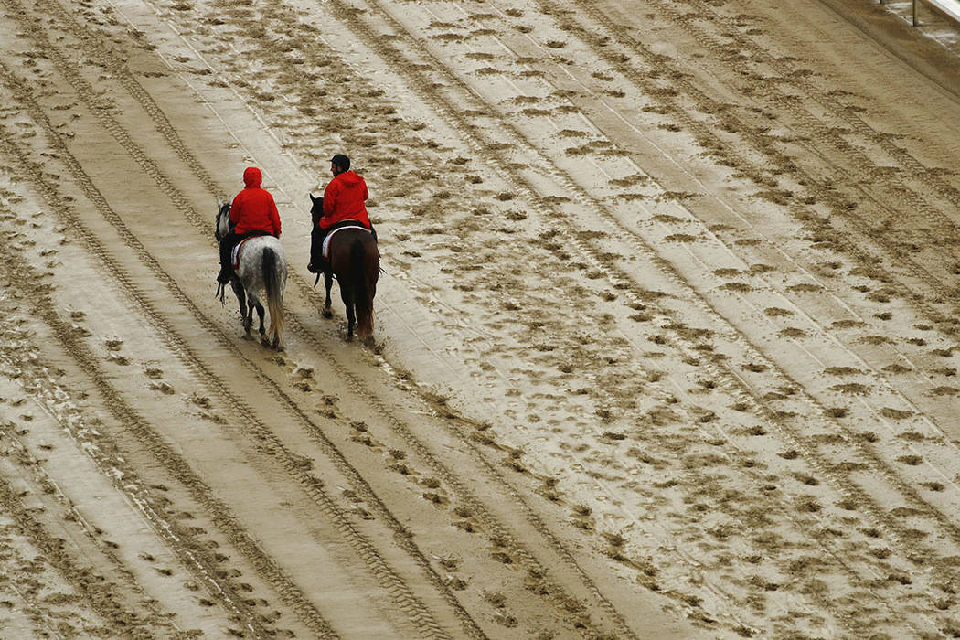Outriders walk on the track before the 144th running of the Kentucky Derby horse race at Churchill Downs Saturday, May 5, 2018, in Louisville, Ky. (AP Photo/Charlie Riedel)