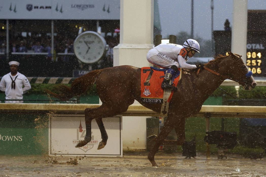 Mike Smith rides Justify to victory before the 144th running of the Kentucky Derby horse race at Churchill Downs Saturday, May 5, 2018, in Louisville, Ky. (AP Photo/Kiichiro Sato)