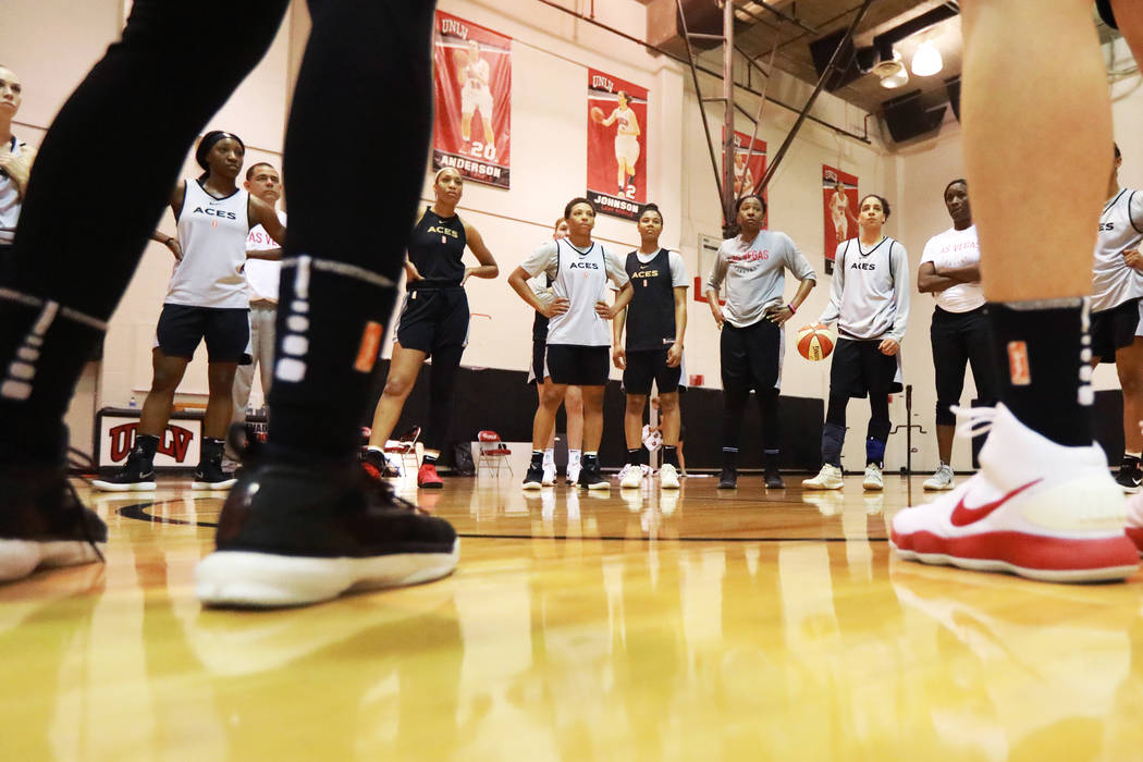 Nia Coffey, a second-year forward with the Las Vegas Aces, center, gathers with her teammates at the Cox Pavilion practice court in Las Vegas on Saturday, May 5, 2018. Andrea Cornejo Las Vegas Rev ...