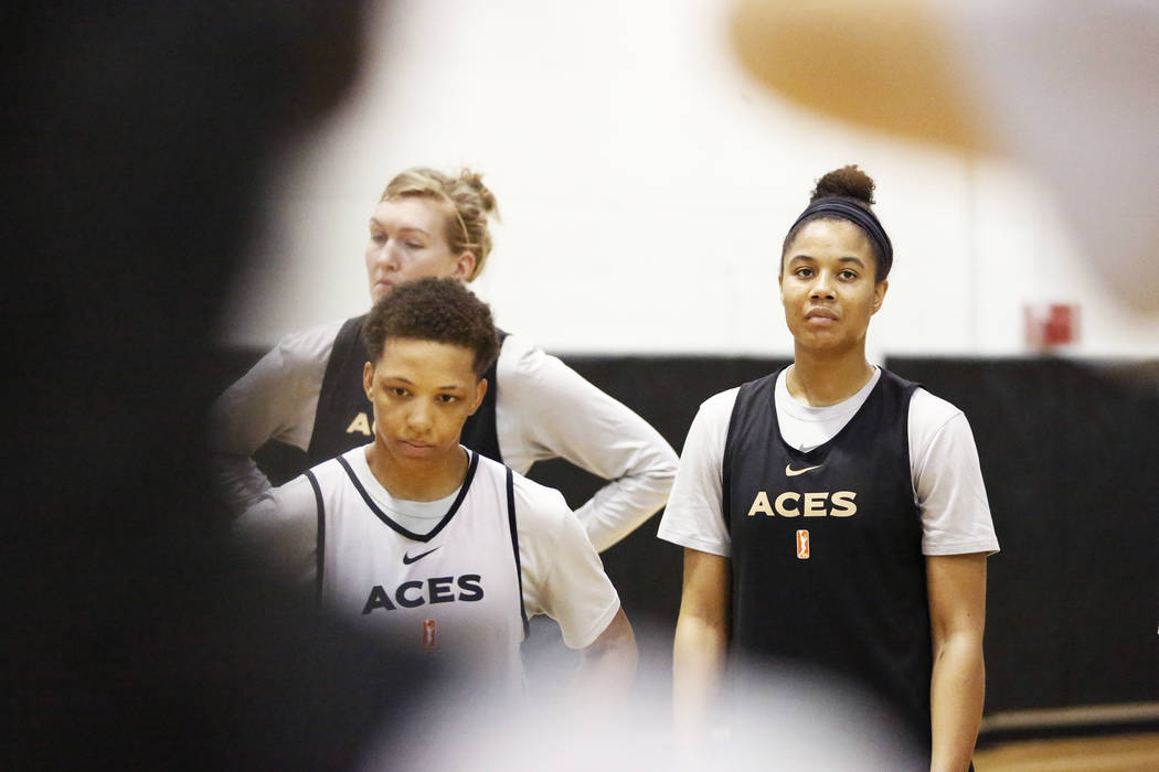 Nia Coffey, a second-year forward with the Las Vegas Aces, right, gathers with the team during practice at the Cox Pavilion practice court in Las Vegas on Saturday, May 5, 2018. Andrea Cornejo La ...