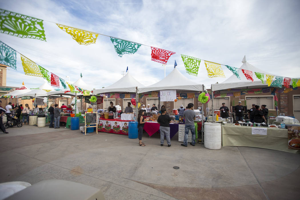 Attendees visit vendor booths during El Tiempo's Cinco de Mayo Fiesta at The Cannery in North Las Vegas, Saturday, May 5, 2018. Richard Brian Las Vegas Review-Journal @vegasphotograph