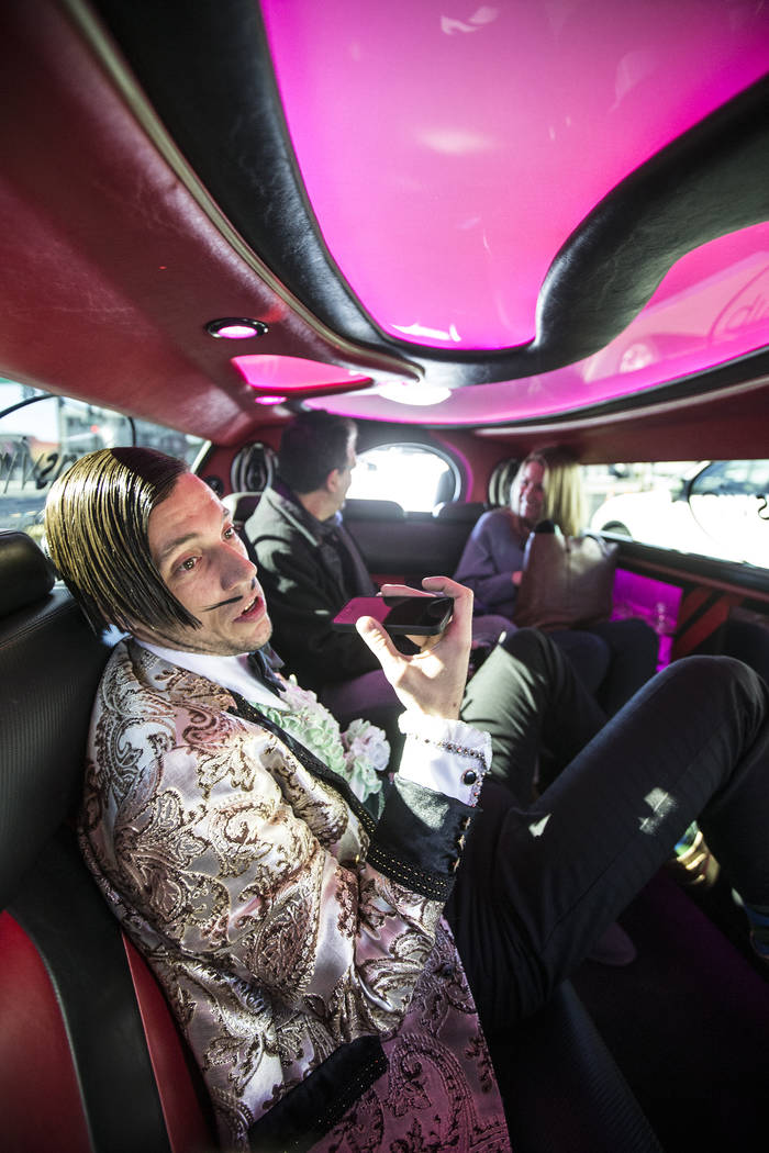"Absinthe's ""The Gazillionaire"" speaks to ""Harry M. Howie"" on the phone en route to a promotional event announcing Spiegelworld's new show OPIUM, which will open on March 13, 2 ..."