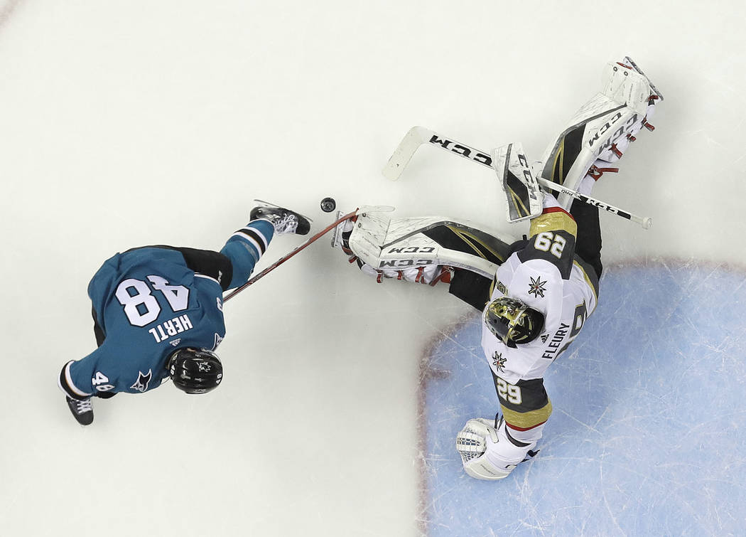 Vegas Golden Knights goaltender Marc-Andre Fleury, right, stops a shot by San Jose Sharks center Tomas Hertl during the second period of Game 6 of an NHL hockey second-round playoff series Sunday, ...