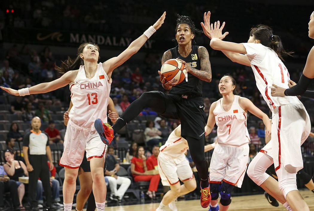 Las Vegas Aces forward Tamera Young (1) gets fouled by China's Mengran Sun (13) and Zhengi Pan during a preseason basketball game at Mandalay Bay Events Center in Las Vegas on Sunday, May 6, 2018. ...