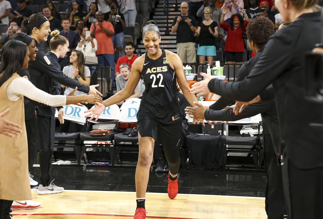 Las Vegas Aces center A'ja Wilson (22) is introduced ahead of a preseason basketball game against the Chinese national team at Mandalay Bay Events Center in Las Vegas on Sunday, May 6, 2018. Richa ...
