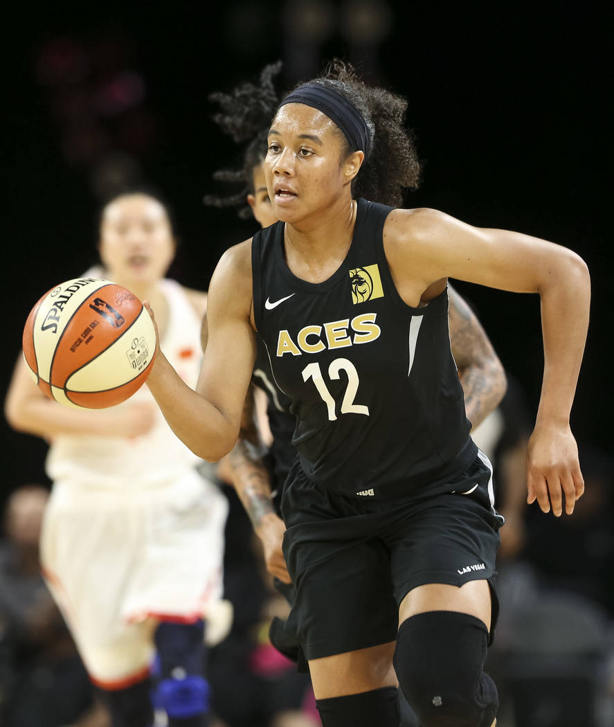 Las Vegas Aces forward Nia Coffey (12) drives the ball against the Chinese national team during a preseason basketball game at Mandalay Bay Events Center in Las Vegas on Sunday, May 6, 2018. Richa ...