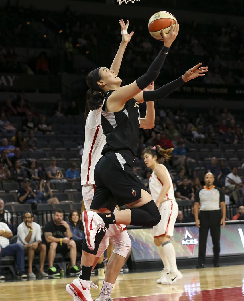 Las Vegas Aces center Ji-Su Park (19)goes up for a shot against China's Zhengi Pan (17) during a preseason basketball game at Mandalay Bay Events Center in Las Vegas on Sunday, May 6, 2018. Richar ...