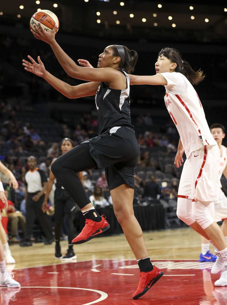 Las Vegas Aces center A'ja Wilson (22) goes up for a shot past China's Zhengi Pan (17) during a preseason basketball game at Mandalay Bay Events Center in Las Vegas on Sunday, May 6, 2018. Richard ...