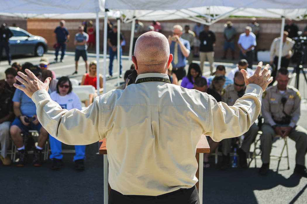 Metro Chaplain Dean Sanner conducts a prayer during ceremony honoring officers Igor Soldo and Alyn Beck and civilian Joseph Wilcox, who were gunned down two years ago, during a plaque dedication ...
