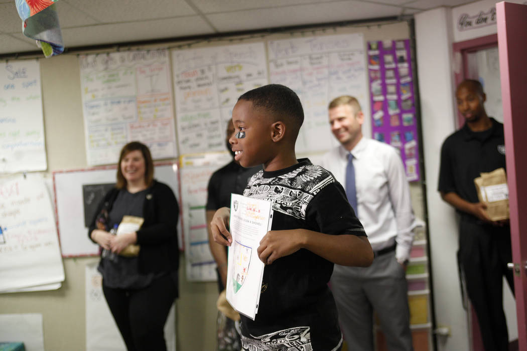 Marrail Parker-Briggs, 9, holds his drawing to show the Raiders players at Gene Ward elementary school in Las Vegas, Wednesday, May 9, 2018. Students participated in a raiders themed drawing conte ...