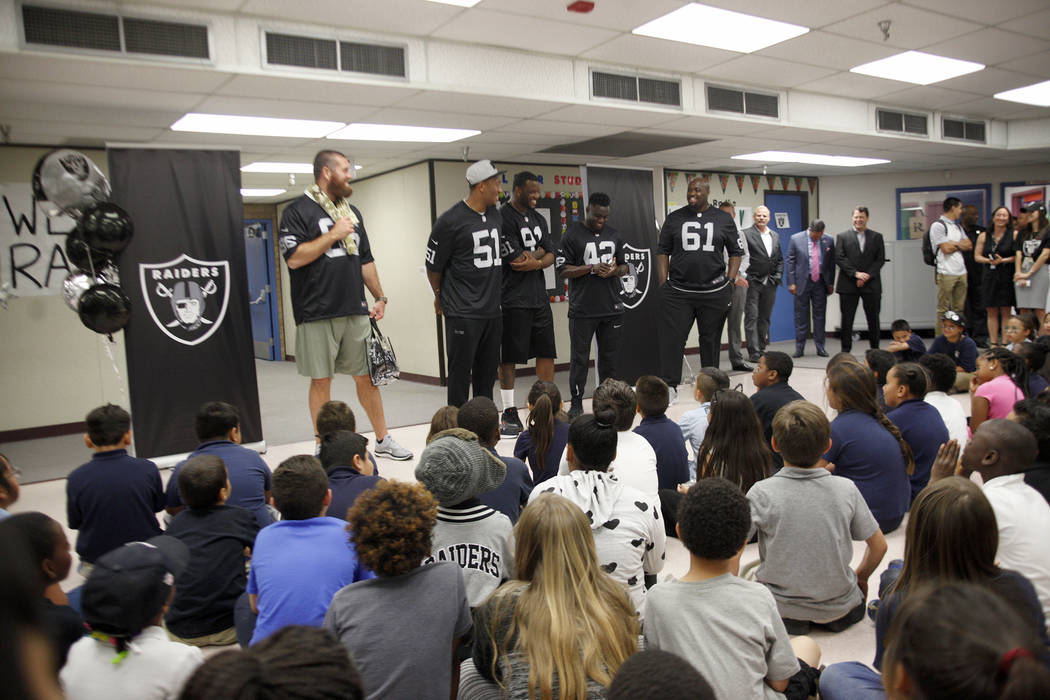 Oakland Raiders players Lee Smith, from left, Bruce Irvin, and Shilique Calhoun, Karl Joseph, and Rodney Hudson speak to students at Gene Ward elementary school in Las Vegas, Wednesday, May 9, 201 ...