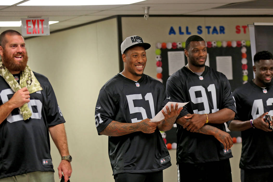 Oakland Raiders player Bruce Irvin announces the winner as fellow players Lee Smith, from left, Shilique Calhoun, and Karl Joseph stand by to speak to students at Gene Ward elementary school in La ...