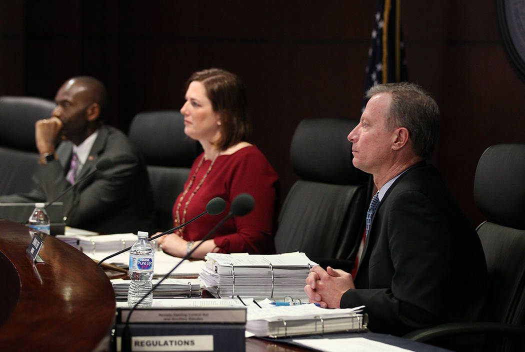 Gaming Control Board members, from left, Terry Johnson, chairwoman Becky Harris and Shawn Reid listen during a March meeting in Las Vegas. (K.M. Cannon Las Vegas Review-Journal)
