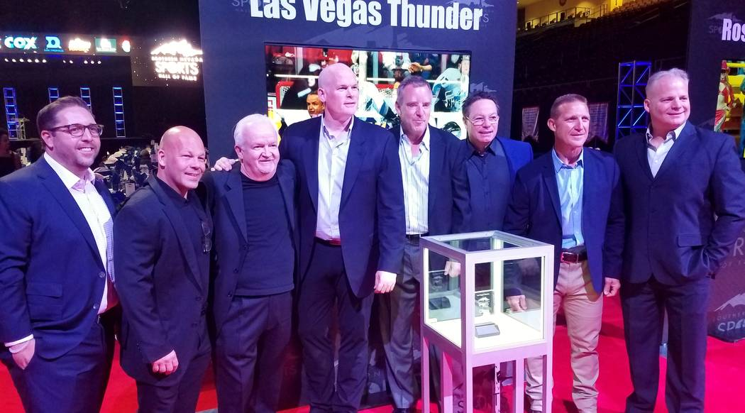 The Las Vegas Thunder, which paved the way for professional hockey in Las Vegas, was inducted into the Southern Nevada Sports Hall of Fame at Orleans Arena Friday night. Shown l to r are former te ...