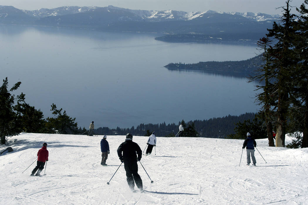 Skiers and snowboarders enjoy the spectacular views of Lake Tahoe during the reopening of Diamond Peak at Incline Village in Lake Tahoe, Nev., Monday, Jan 9, 2006. (Tim Dunn/The Gazette-Journal, AP)
