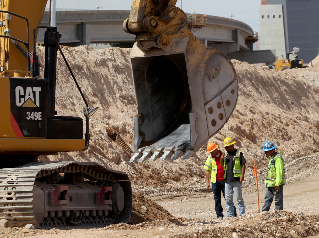 Work continues May, 8, 2018, on the high occupancy vehicle exit lanes to the Neon Gateway in downtown Las Vegas between what will be the northbound and southbound lanes of Interstate 15 as part of ...