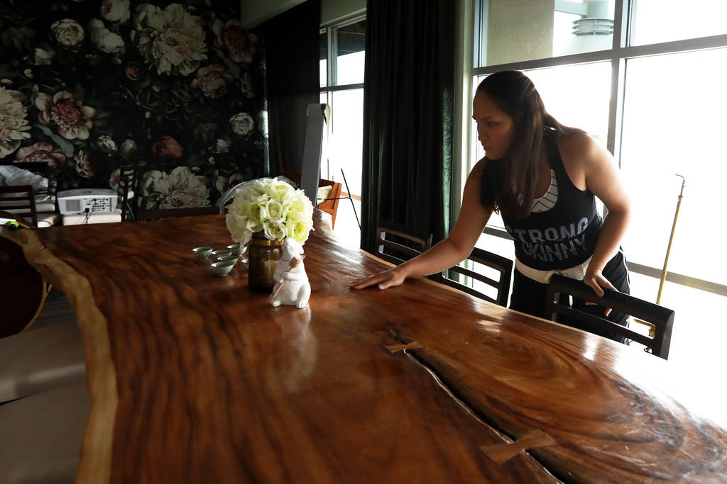 Ash Rebosa cleans up an area of The Stove, which will offer a main dining room, a Coffee Chill room and a Twisted Tea Room, in Henderson, Nevada on Sunday, May 6, 2018. Andrea Cornejo Las Vegas Re ...