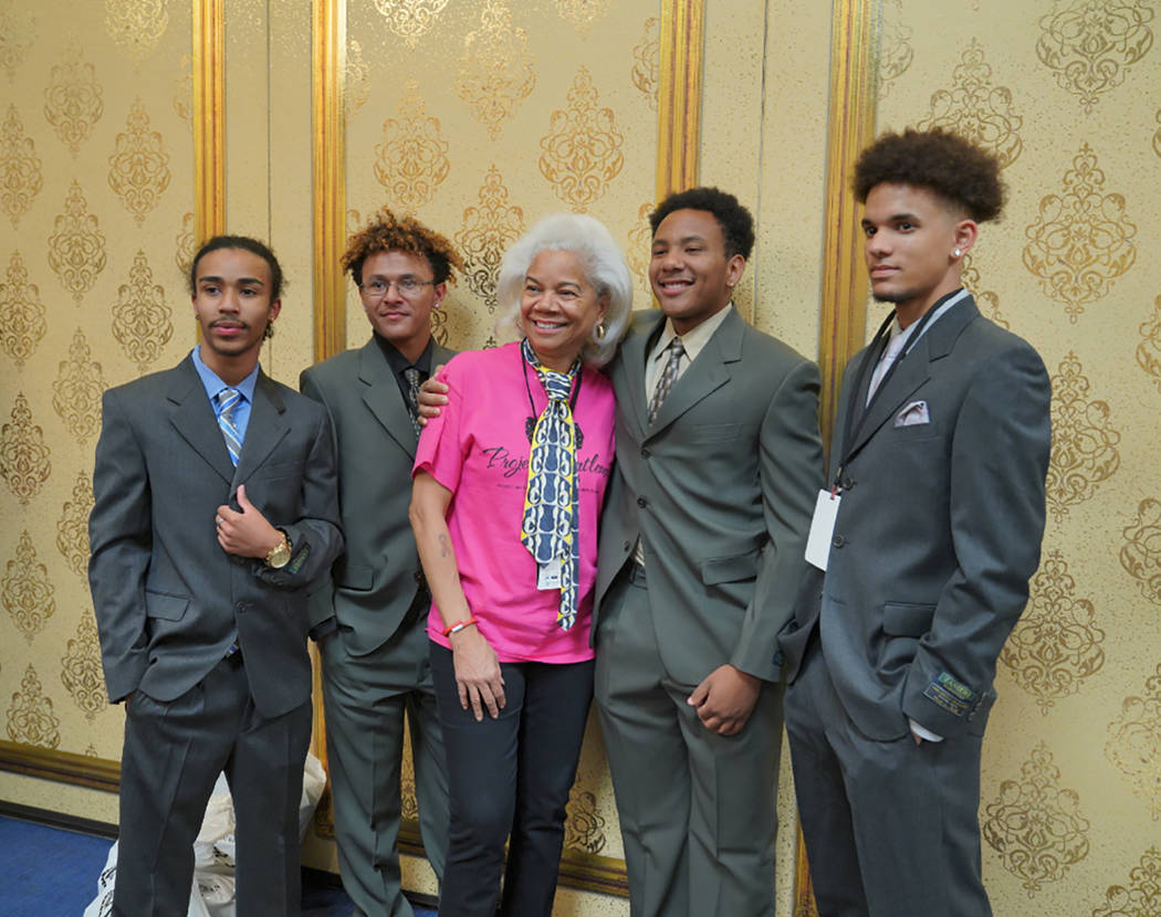 Robin Price (middle) poses for a photo with students at the Project Gentlemen event. From left, Dhane Stagger, Sheronne Zackery, Robin Price, Elijah Henderson and Diente Dreher. Photo by Cashman ...