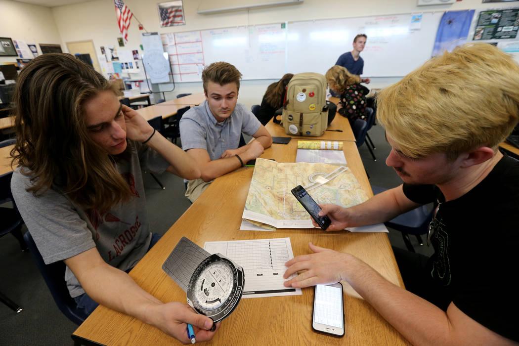Rancho High School seniors, from left, Matthew Murrietta, Sebastian Crawford and William Bennett make a flight plan in class Wednesday, May 9, 2018. K.M. Cannon Las Vegas Review-Journal @KMCannonPhoto