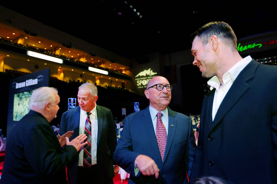 Forrest Griffin, former UFC light heavyweight champion, from right, talks with Rossi Ralenkotter as Jim Reitz speaks to Bob Strumm, the Las Vegas Thunder's former general manager, before the South ...