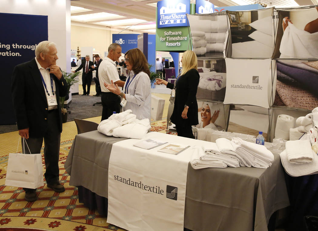 Virginia King, center, regional director for Standardtextile, speaks to a potential customer during the annual convention from the American Resort Development Association at Caesars Palace hotel-c ...