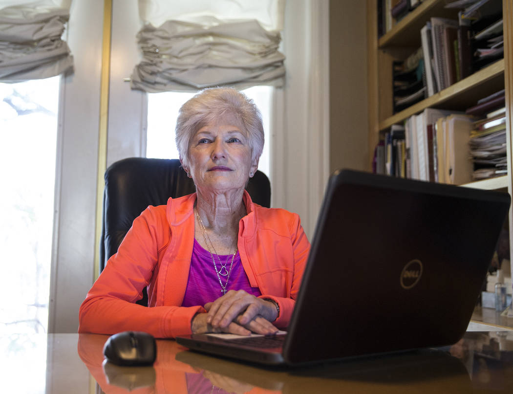 Writer/advocate Nancy Nelson, 74, works on a poem in her office in Las Vegas. Nelson was diagnosed with early-onset Alzheimer's disease in 2013 and attributes much of her continuing health to diet ...