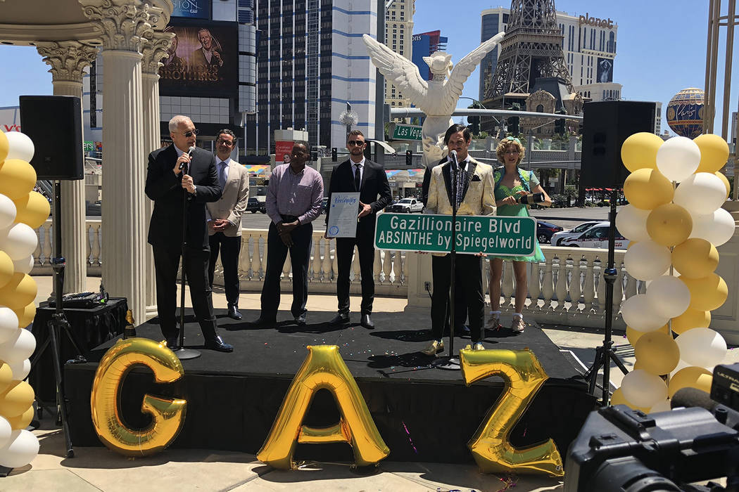 Caesars Palace President Gary Selesner, far left, is joined by hotel GM Sean McBurney and Clark County Commissioner Lawrence Weekly in a ceremony re-naming Las Vegas Boulevard Gazillionaire Blvd. ...