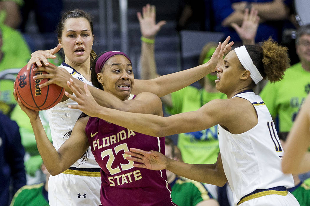 Florida State's Ivey Slaughter (23) is pressured by Notre Dame's Kathryn Westbeld, left, and Brianna Turner (11) during the second half of an NCAA college basketball game Sunday, Feb. 26, 2017, in ...