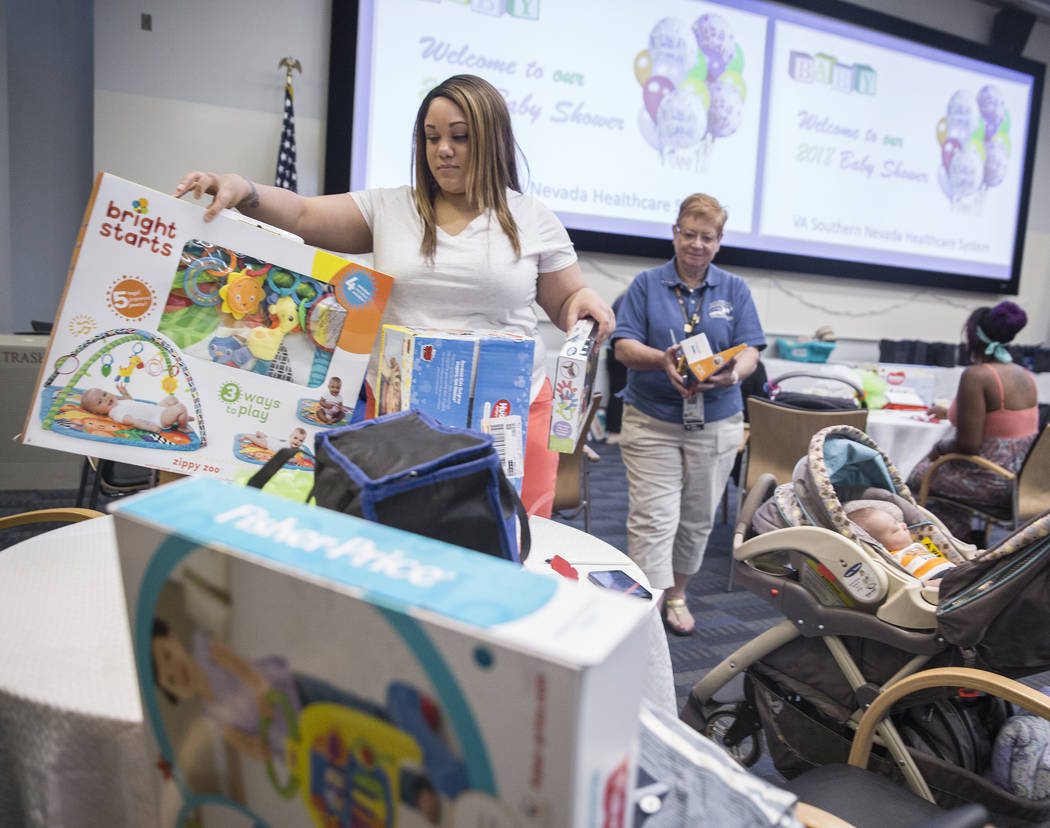 Chanell Parsons picks up a childrens toy during a baby shower sponsored by the Veteran's Affairs Southern Nevada Healthcare System in partnership with the Elizabeth Dole Foundation on Monday, May ...