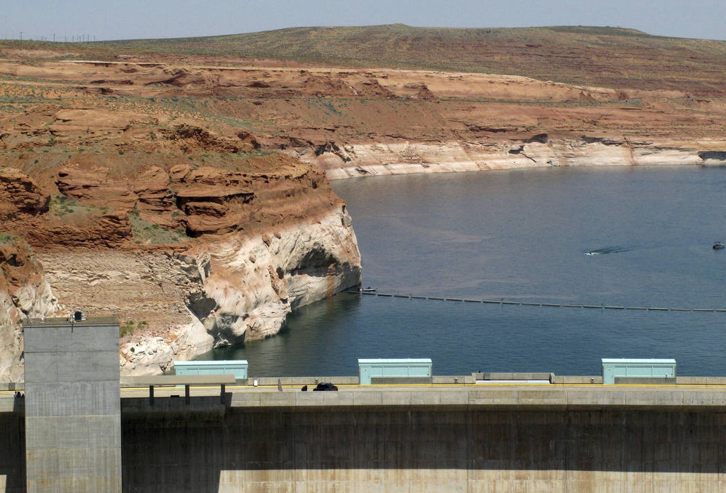 FILE - In this June 21, 2015, file photo, Lake Powell is viewed behind Glen Canyon Dam near Page, Ariz. Forecasters say this year's outlook for the most important river in the Southwestern U.S. re ...