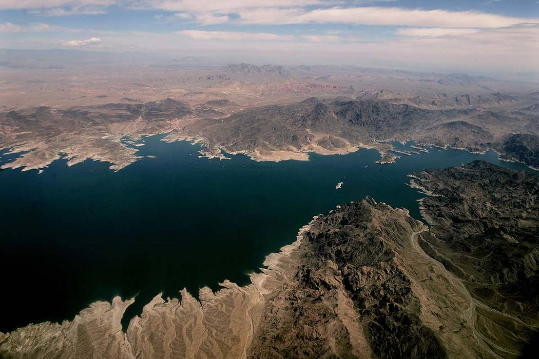 Lake Mead, which separates Arizona, bottom, and Nevada, top, is seen from the air, east of Las Vegas in this May 1, 2005, photo. Forecasters say this year's outlook for the most important river in ...