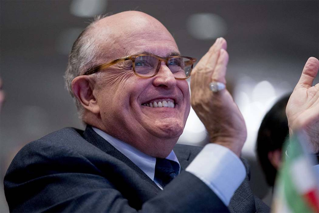 Rudy Giuliani, an attorney for President Donald Trump, applauds at the Iran Freedom Convention for Human Rights and democracy at the Grand Hyatt, Saturday, May 5, 2018, in Washington. (Andrew Harn ...