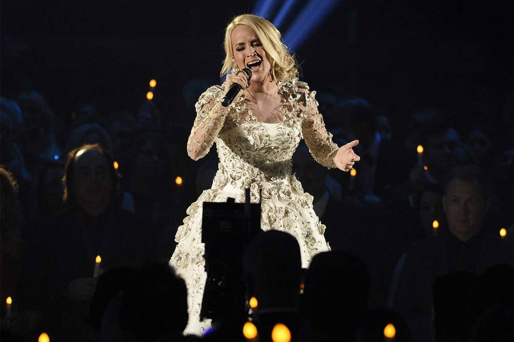 """In this Wednesday, Nov. 8, 2017, file photo, Carrie Underwood performs """"Softly and Tenderly"""" during an In Memoriam tribute at the 51st annual CMA Awards at the Bridgestone Arena in Nashville, Tenn ..."""