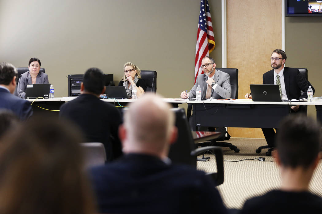 Members of the Nevada Department of Education listen to speakers during a hearing on proposed gender diverse regulations at the Department of Education's board room in Las Vegas on Friday, March 3 ...