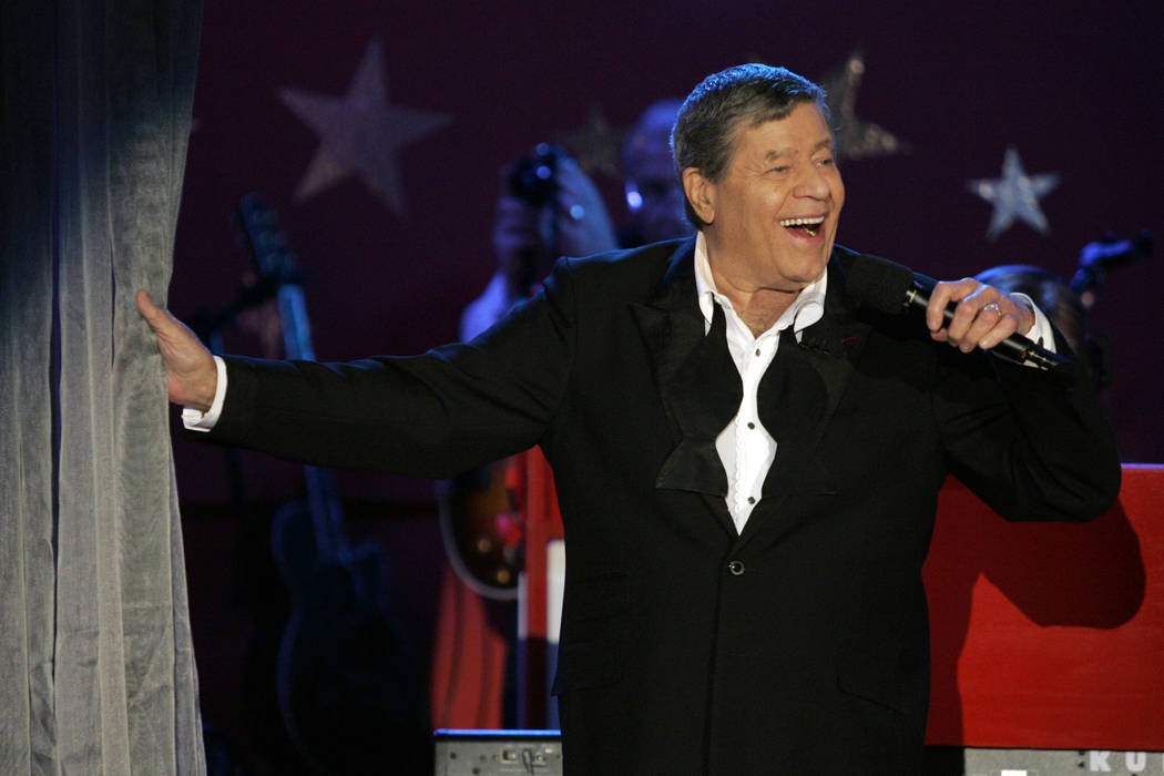Longtime host Jerry Lewis performs during the Muscular Dystrophy Association telethon in Beverly Hills, Calif. Lewis, the comedian and director whose fundraising telethons became as famous as his ...