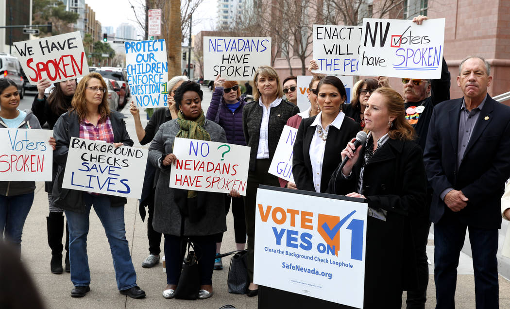 Elizabeth Becker of Nevada MOMs Demand Action speaks with supporters of Question 1 outside the Regional Justice Center in Las Vegas on Friday, Feb. 23, 2018. She called on Gov. Brian Sandoval and ...