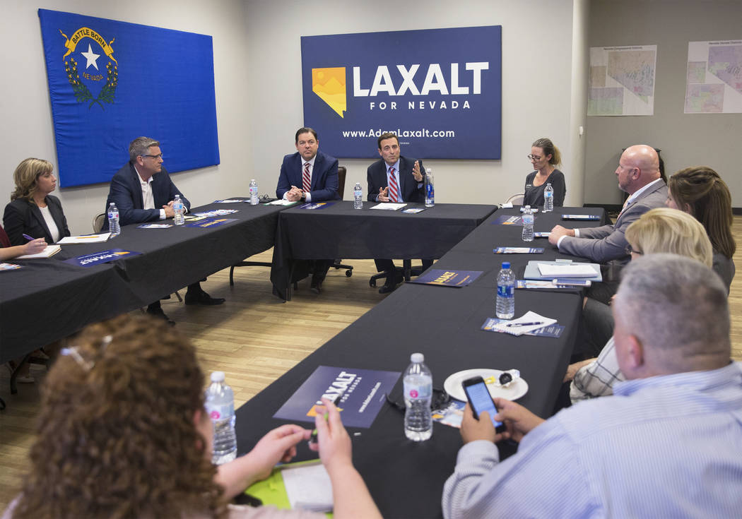 Adam Laxalt, middle, Nevada Attorney General and gubernatorial candidate, answers a question during a round table discussion on education reform on Wednesday, April 4, 2018, at Laxalt's campaign o ...