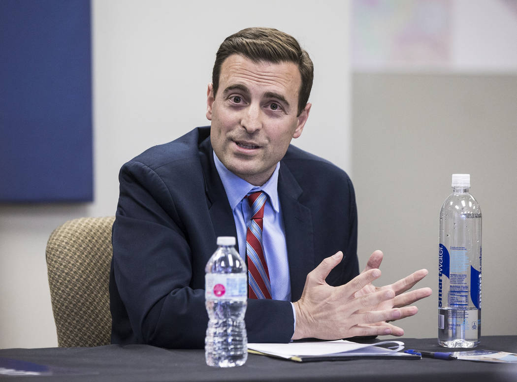 Adam Laxalt, Nevada Attorney General and gubernatorial candidate, answers a question during a round table discussion on education reform on Wednesday, April 4, 2018, at Laxalt's campaign office, i ...