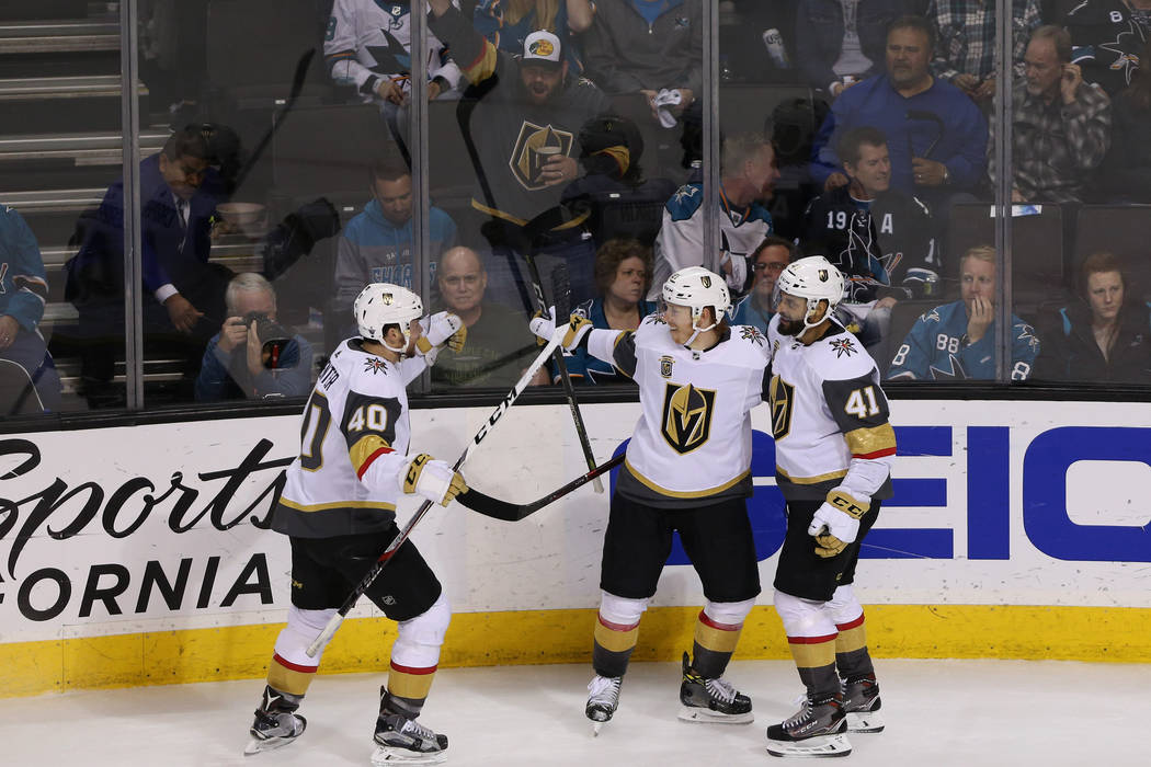 Vegas Golden Knights center Cody Eakin (21), center, celebrate his score with center Ryan Carpenter (40), left, and left wing Pierre-Edouard Bellemare (41), during the third period in Game 6 of an ...