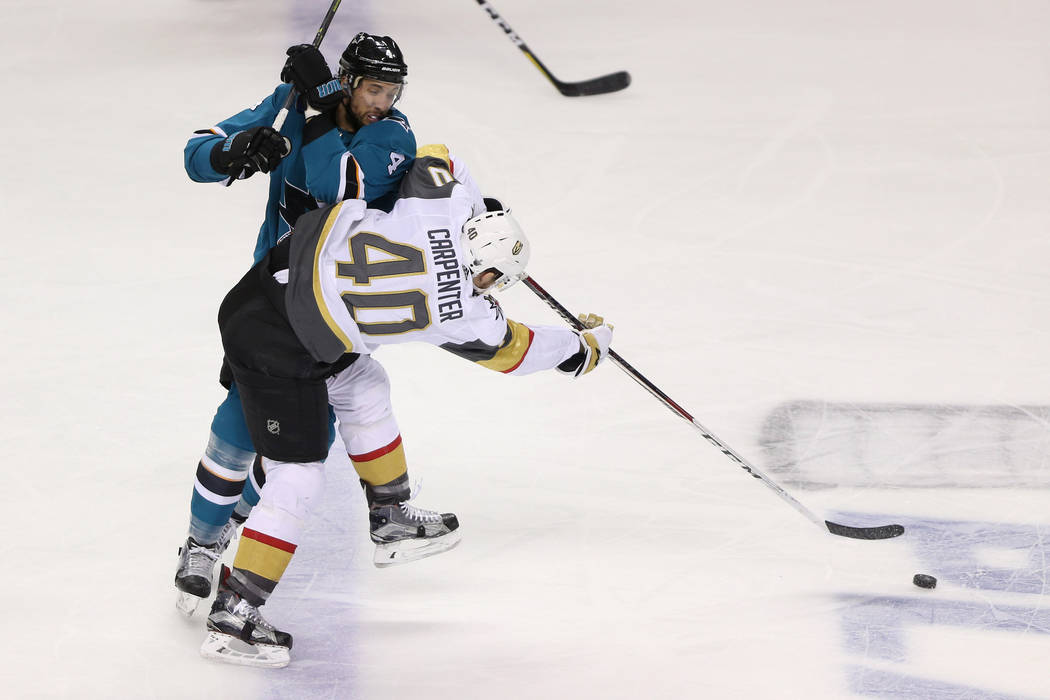Vegas Golden Knights center Ryan Carpenter (40) takes a shot under pressure from San Jose Sharks defenseman Brenden Dillon (4) during the third period in Game 6 of an NHL hockey second-round playo ...