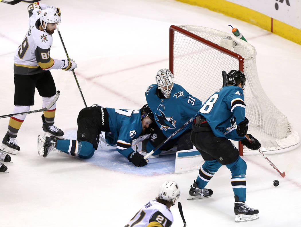 San Jose Sharks defenseman Joakim Ryan (47), goaltender Martin Jones (31) and center Tomas Hertl (48) defends against the Vegas Golden Knights right wing Alex Tuch (89) and center Cody Eakin (21) ...